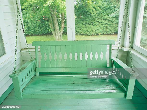 Lone porch swing on front of home, close-up