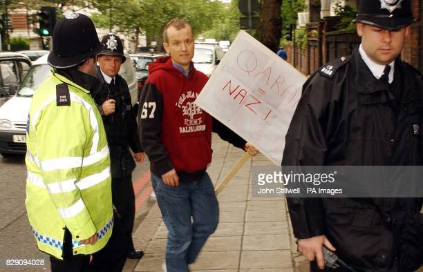 Lone protester Mr Alisdare Hickson 41 from Bethnal Green east London is led away from the front of Central London Mosque by police officers after the...