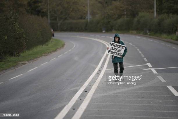 A lone protestor demonstrates outside Workmen Cuadrilla's shale gas fracking drilling rig near Westby on October 12 2017 in Blackpool England...