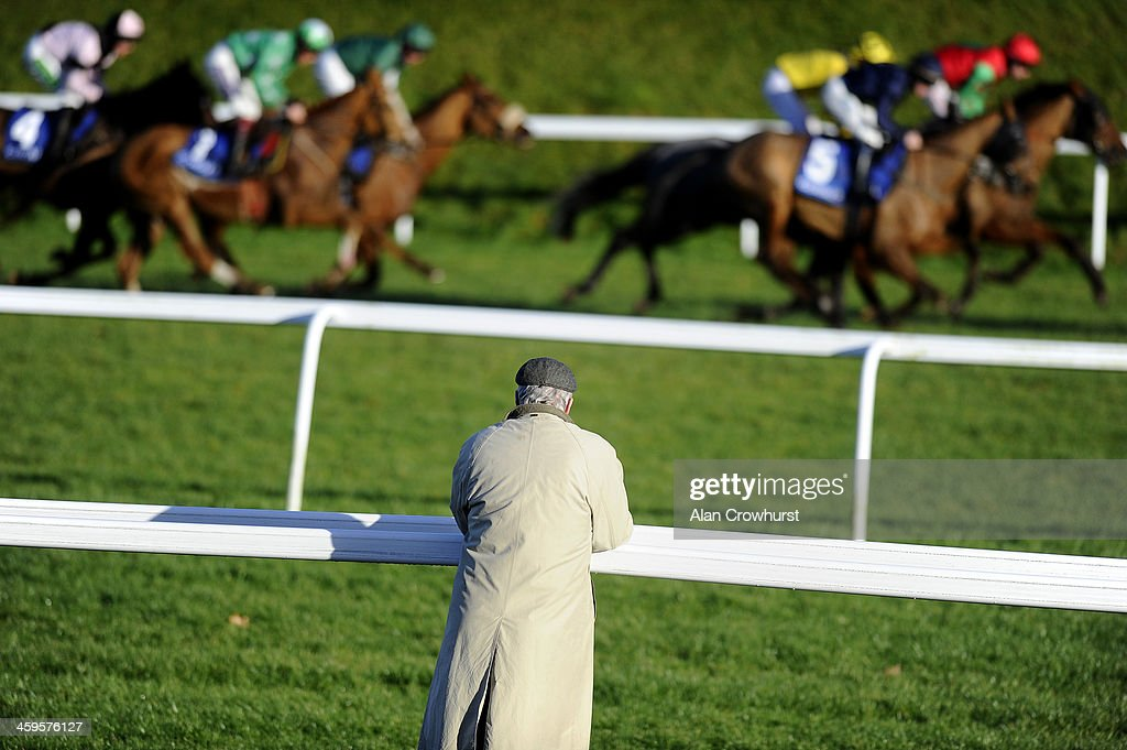 A lone racegoer watches the action as the runners make their way downhill to the bottom bend at Chepstow racecourse on December 28, 2013 in Chepstow, Wales.