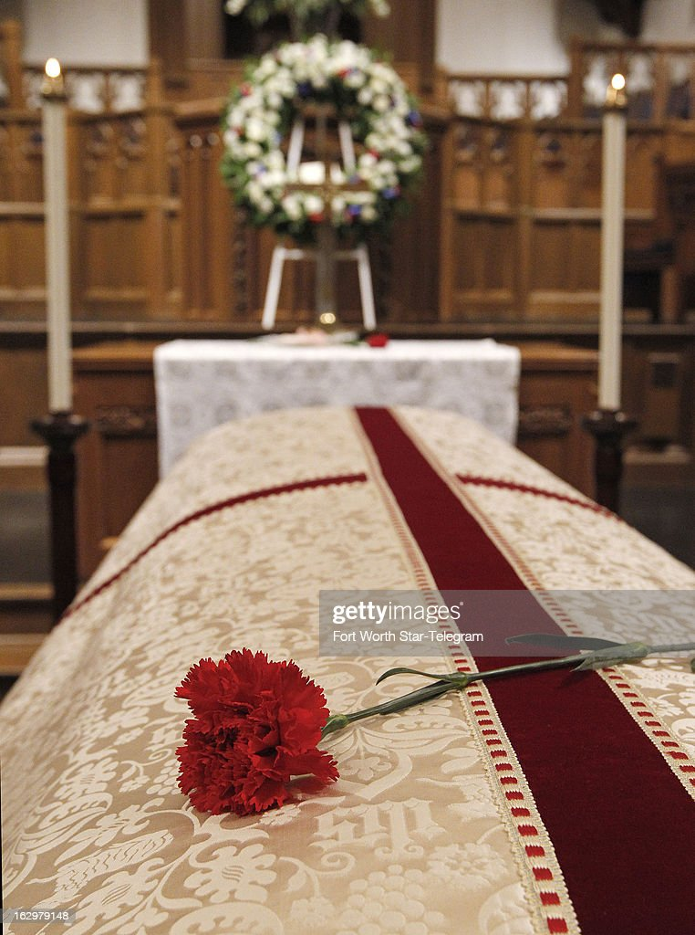 A lone rose lies on the coffin of Van Cliburn following a visitation at Broadway Baptist Church in Fort Worth, Texas, on Saturday, March 2, 2013. The internationally acclaimed musician died Wednesday at 78.