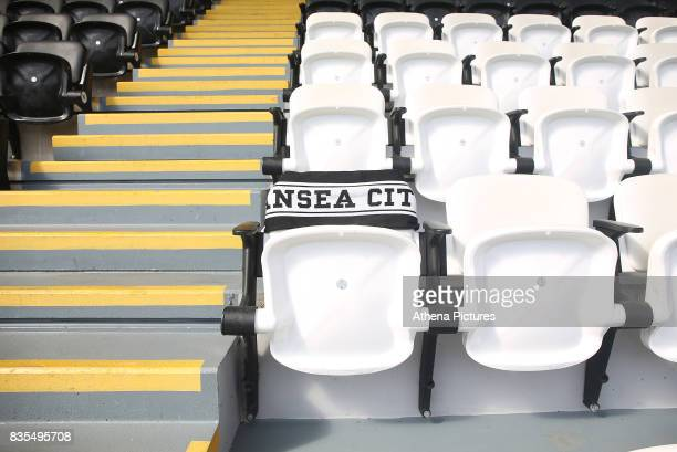 A lone seat in the directors area is marked with a scarf in memory of Gwilym Joseph MBE Swansea City's honorary president who passed away earlier...