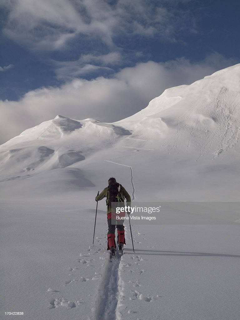 lone skier on a deserted slope : Stock Photo