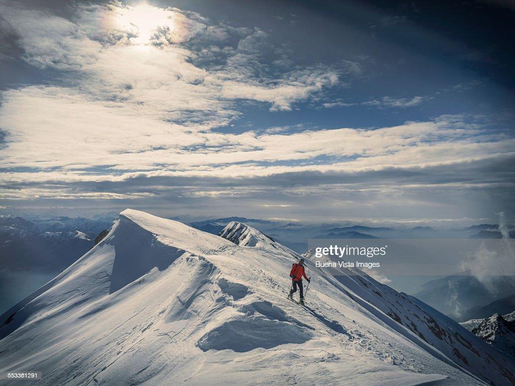 Lone skier on a snowy ridge