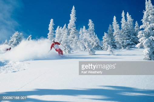 Lone skier riding through powder, British Columbia, Canada : Stock Photo