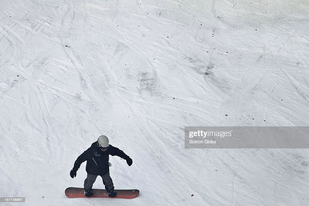 A lone snowboarder makes their way down Exodus run at Loon Mountain Resort in Lincoln, New Hampshire on November 24, 2012.