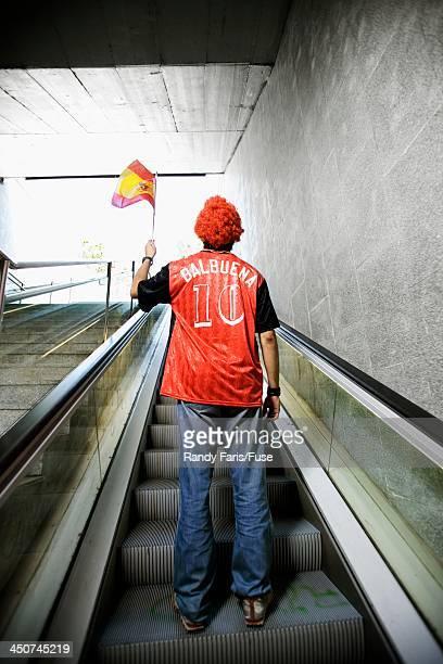 Lone Soccer Fan on Escalator