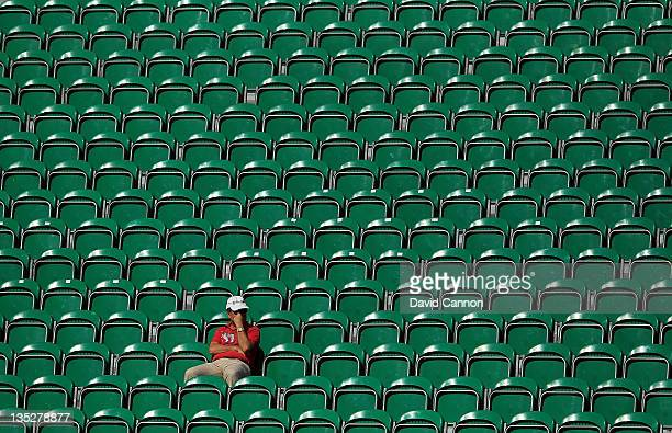 A lone spectator in the empty grandstand on the 18th hole watching the early groups finishing during the first round of the Dubai World Championship...