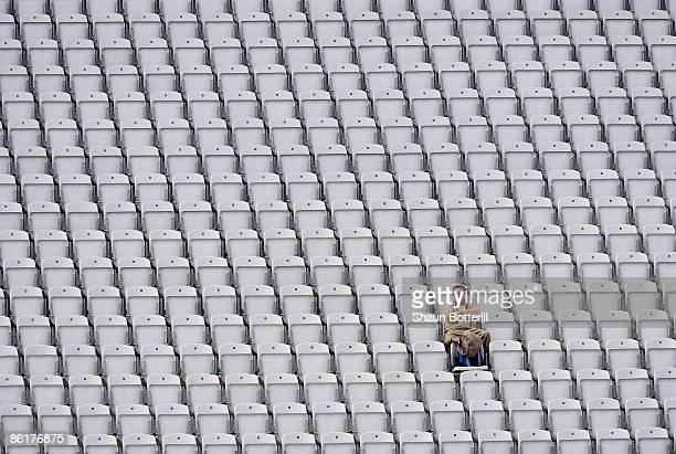 A lone spectator watches from the stands during the third day of the LV County Championship match between Nottinghamshire and Worcestershire at the...