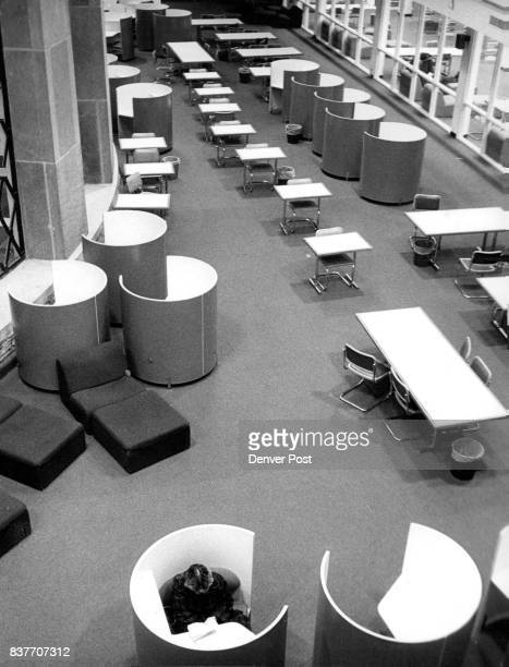 A lone student studies in the library at the University of Colorado's Boulder campus Ordinarily the library is jammed and will be again when...