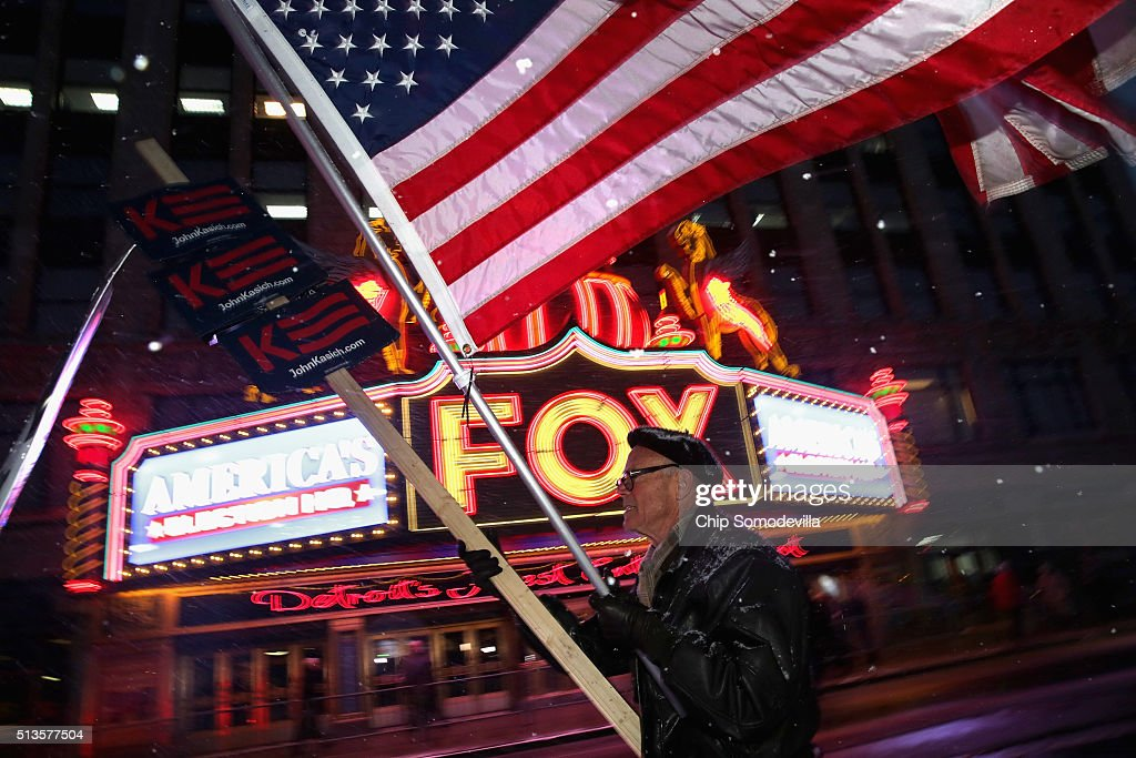 A lone supporter of Republican presidential candidate Ohio Gov John Kasich marches the historic Fox Theatre before the GOP presidential debate March...