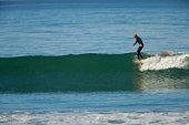 Lone surfer hangs five.