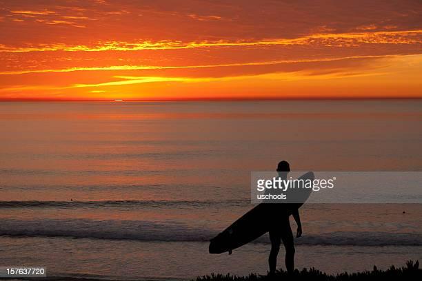 Lone Surfer Watching Sunset