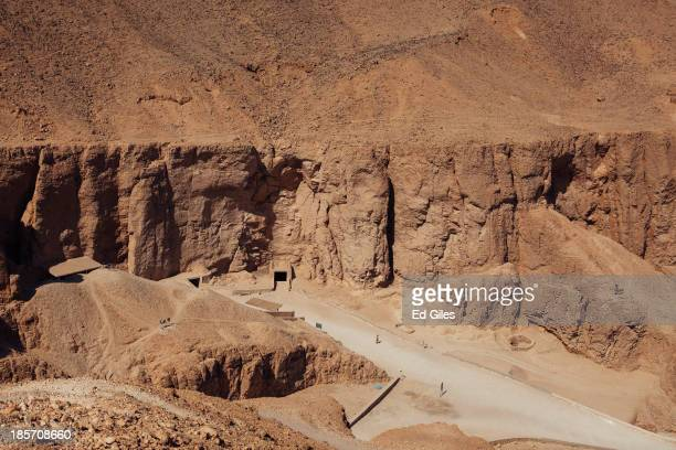 A lone tourist walks through the Valley of the Kings on October 23 2013 in Luxor Egypt The Valley of the Kings lies on the west bank of the Nile...