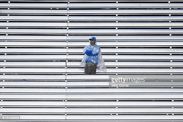 A lone UNC Tar Heel football fan looks on during a loss against the Virginia Tech Hokies at Kenan Stadium on October 8 2016 in Chapel Hill North...