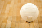 Volleyball on Wood Floor