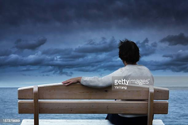 Loneliness, Grief, Sadness, or Depression Expressed by Woman Waiting Alone