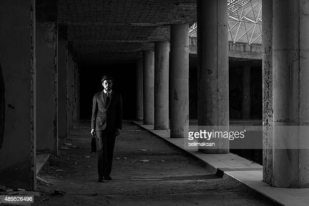 Lonely Businessman In Abandoned Modern Building