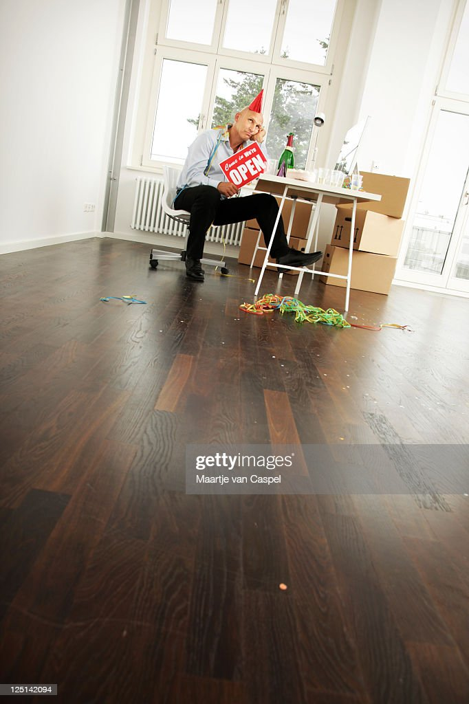 Lonely Businessman - Open for Business : Stock Photo