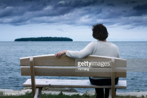 Lonely, Divorced or Widowed, Depressed, Sad Woman Contemplating Life Alone
