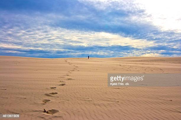 Lonely person walking on a Dune