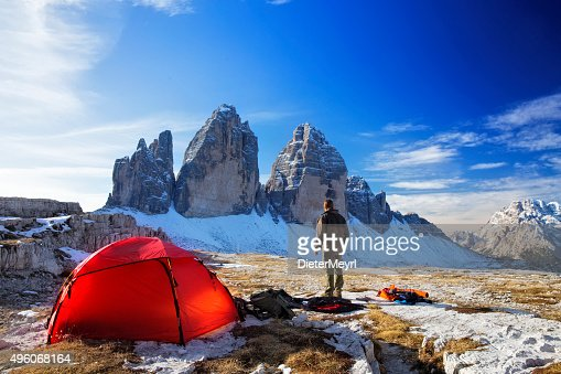 Lonely  Photographer with tent at the three Pinnacles in wintertime