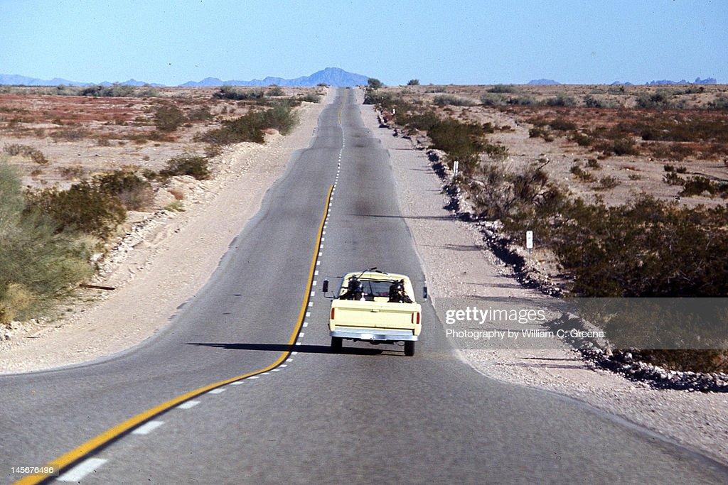 Lonely road in Mojave desert : Stock Photo