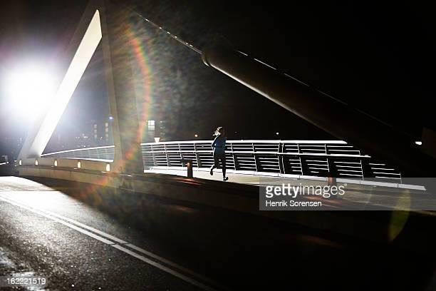 lonely runner on bridge