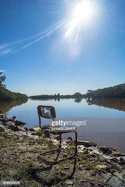 A lonely seat by the Myall River| Australia