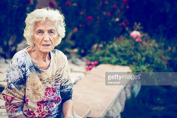 Lonely Senior Woman Sitting Outdoors