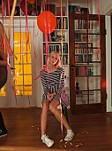 Lonely teen at party holding red balloon