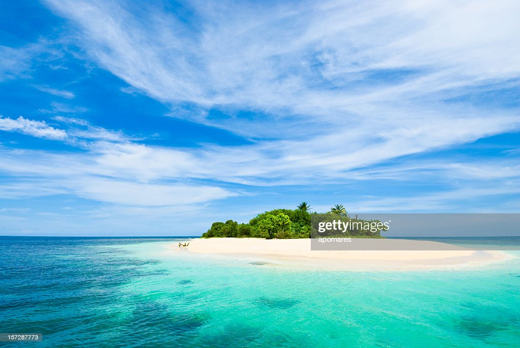 Small tropical desert island with turquoise waters and clear sky : Stock Photo