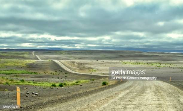 Long and winding dirt road in Myvatn, Iceland