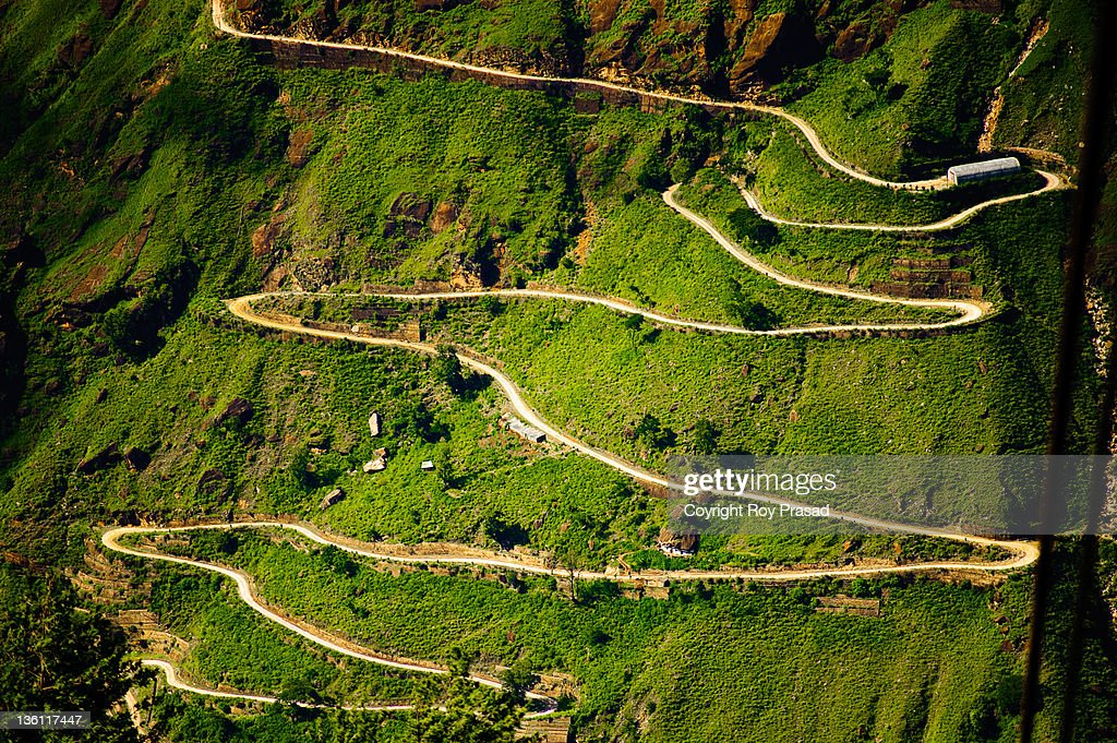 Long and winding road. Aerial view of mountain in Himalayan range at Auli, India.