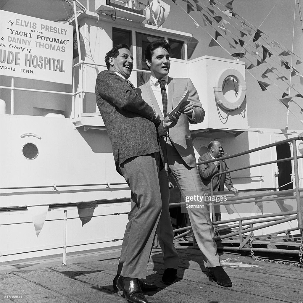Long Beach California Elvis Presley turns over the papers for the SS Potomac former presidential yacht of the late President Franklin D Roosevelt to...