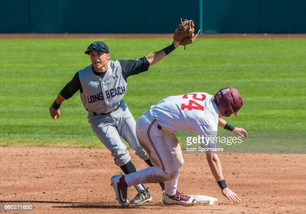 Long Beach St infielder Laine Huffman finishes the play at second during the regular season game between the Long Beach Dirt Bags and the Stanford...