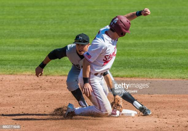 Long Beach St infielder Laine Huffman gets the tag on Stanford pitcher Quinn Brodey during the regular season game between the Long Beach Dirt Bags...