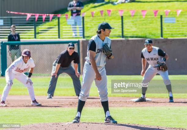Long Beach St pitcher Sebastian Sanchez waits for a signal from his catcher during the regular season game between the Long Beach Dirt Bags and the...
