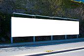 Long billboard blank frame mockup with rock wall