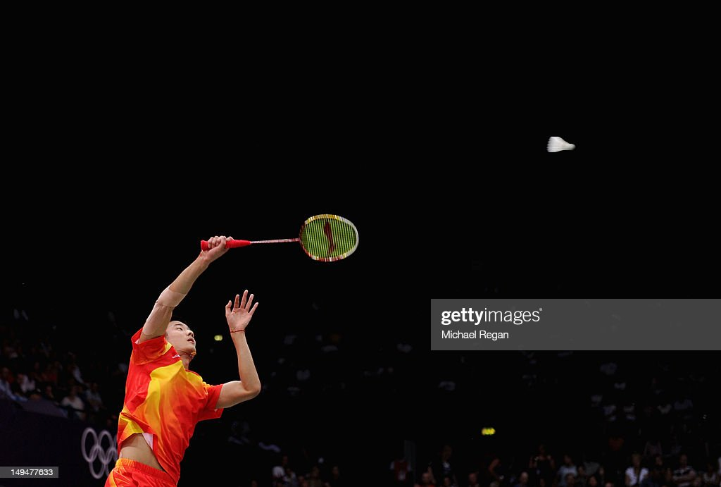 Long Chen of China returns a shot against Boonsak Ponsana of Thailand during their Men's Singles Badminton on Day 2 of the London 2012 Olympic Games at Wembley Arena on July 29, 2012 in London, England.