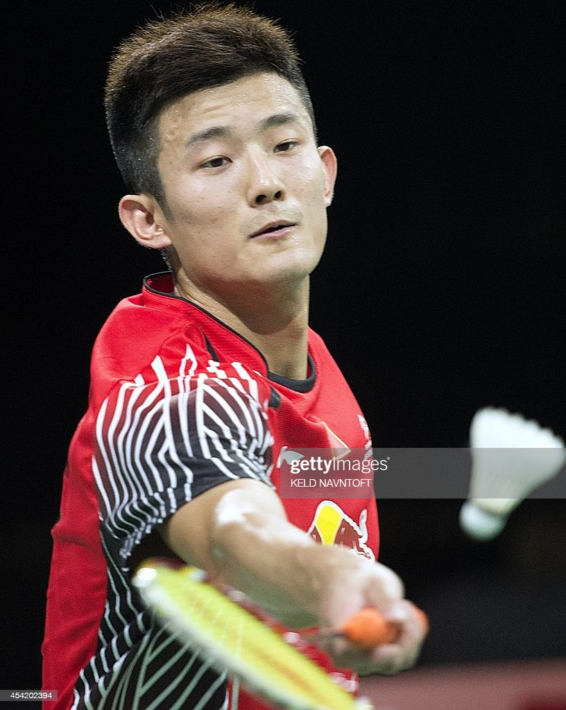 Long Chen of China returns against Luka Wraber of Austria during their match at the 2014 BWF Badminton World championships held at the Ballerup Super Arena in Copenhagen on August 26, 2014.