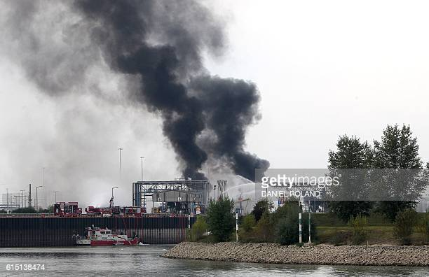 TOPSHOT A long column of smoke rises from the Chemical plant of the BASF site in Ludwigshafen western Germany on October 17 2016 Several people were...