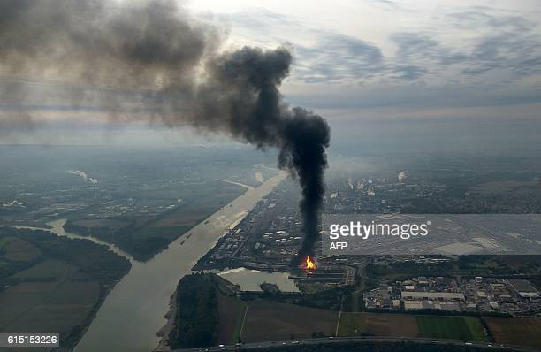 TOPSHOT A long column of smoke rises from the Chemical plant of the BASF site in Ludwigshafen western Germany on October 17 2016 One person was...