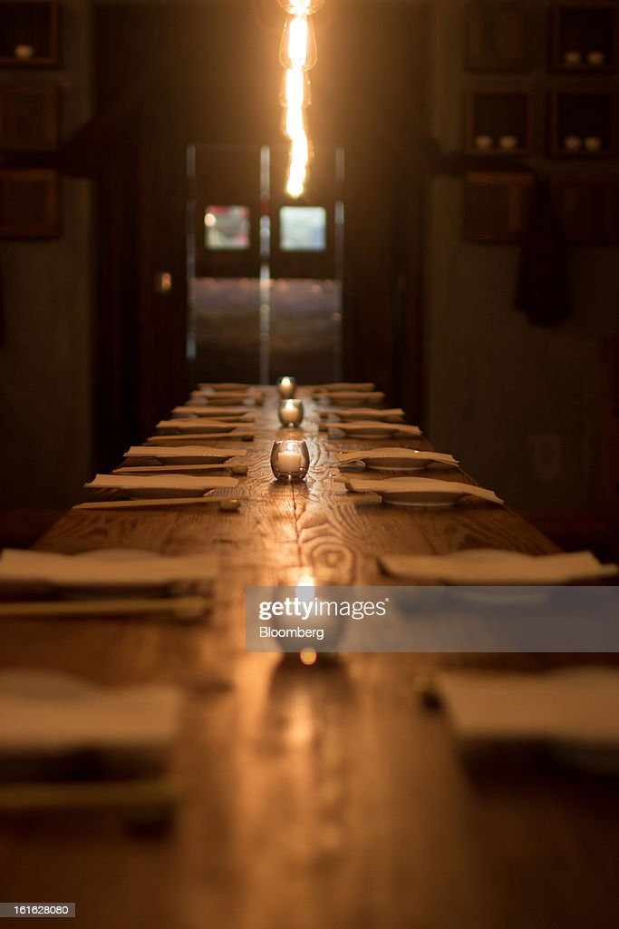 A long communal table stands in the middle of Hanjan Korean restaurant in New York, U.S, on Monday, Feb. 11, 2013. Hooni Kim, Korean chef and restaurateur, owns two Korean restaurants in New York, Hanjan and Michelin-starred Danji, his first restaurant. Photographer: Philip Lewis/Bloomberg via Getty Images
