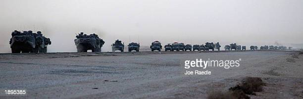 A long convoy of US Marine vehicles drive down the road April 4 2003 as they move through central Iraq The Marines continue to sweep through the...