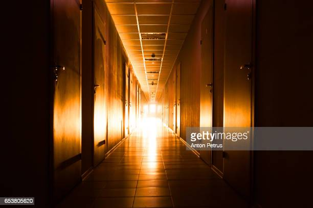Long corridor with light at the end