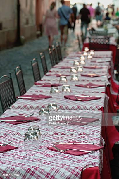 Long dinner table in narrow lane, Rome, Italy