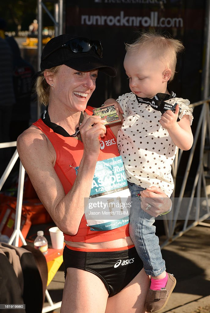 Long distance runner Deena Kastor wins first place at the Kaiser Permanente Rock 'n' Roll Half Marathon and Mini Marathon to benefit CureMito!at the Rose Bowl on February 17, 2013 in Pasadena, California.
