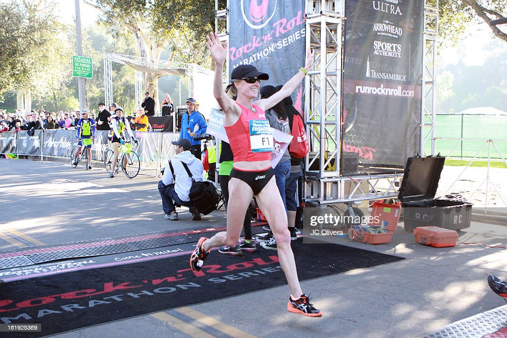 Long distance runner Deena Kastor wins first place at the Kaiser Permanente Rock 'N' Roll Pasadena Half Marathon Benefiting CureMito! at Rose Bowl on February 17, 2013 in Pasadena, California.