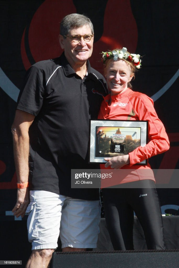 Long distance runner <a gi-track='captionPersonalityLinkClicked' href=/galleries/search?phrase=Deena+Kastor&family=editorial&specificpeople=240301 ng-click='$event.stopPropagation()'>Deena Kastor</a> (R) wins first place at the Kaiser Permanente Rock 'N' Roll Pasadena Half Marathon Benefiting CureMito! at Rose Bowl on February 17, 2013 in Pasadena, California.